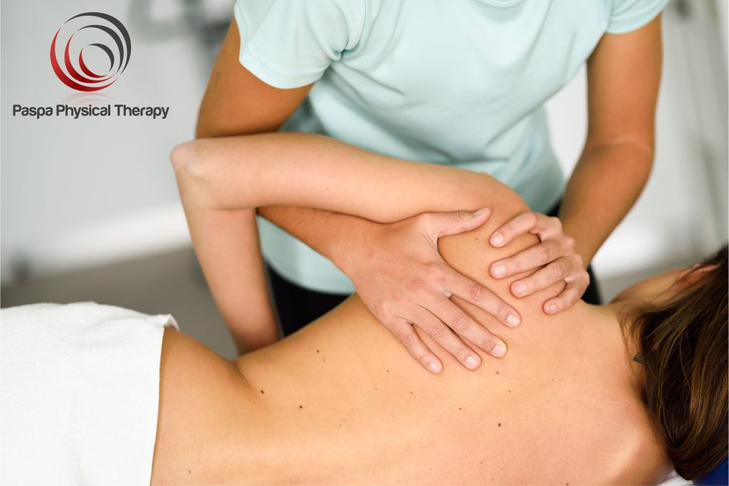 Physical Therapist performing deep tissue massage for a frozen shoulder - Paspa PT, Manhattan, NY