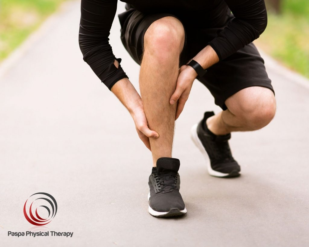 Man suffering from an ankle sprain while running - Paspa PT